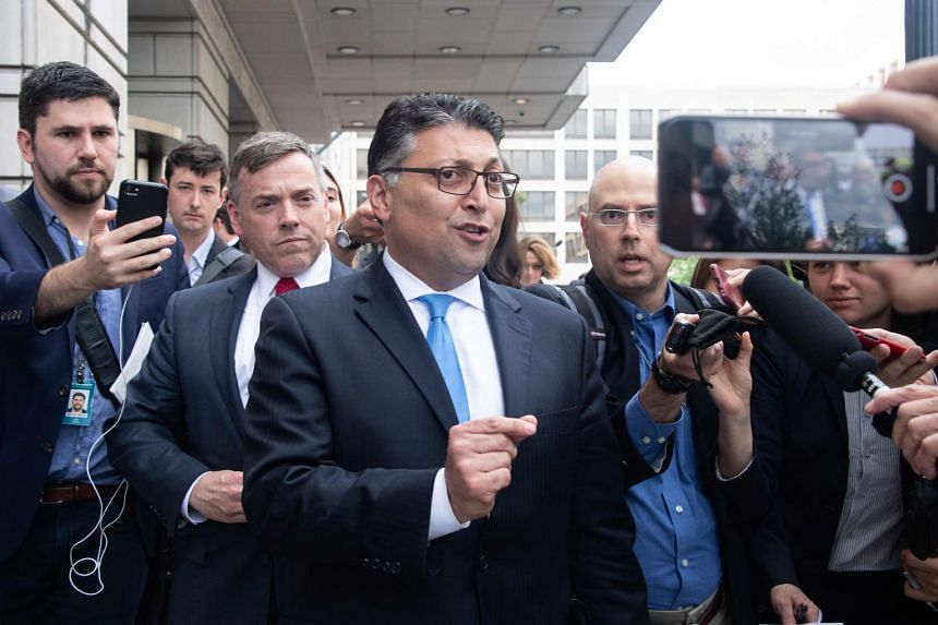 US Assistant Attorney General Makan Delrahim speaks to the press after a court ruled that the merger between AT&T and Time Warner could go ahead in Washington, DC, on June 12, 2018.