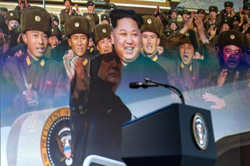 A short video, produced by the White House for US President Donald Trump to show North Korean leader Kim Jong Un during their historic summit, screens for journalists at press conference at the Capella Singapore, on June 12, 2018.