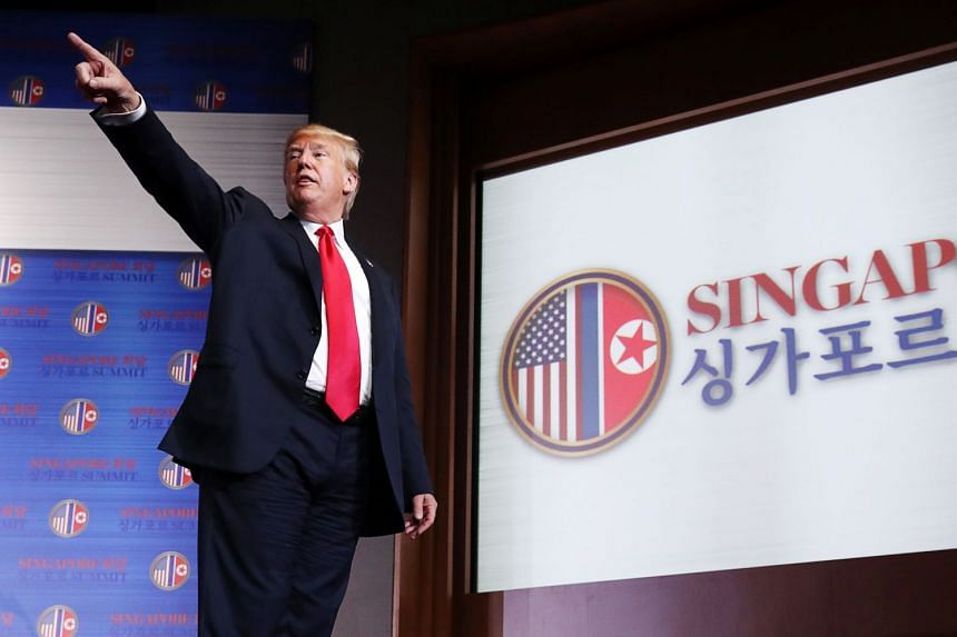US President Donald Trump reacts at a news conference after his meeting with North Korean leader Kim Jong Un at the Capella Singapore, on June 12, 2018.