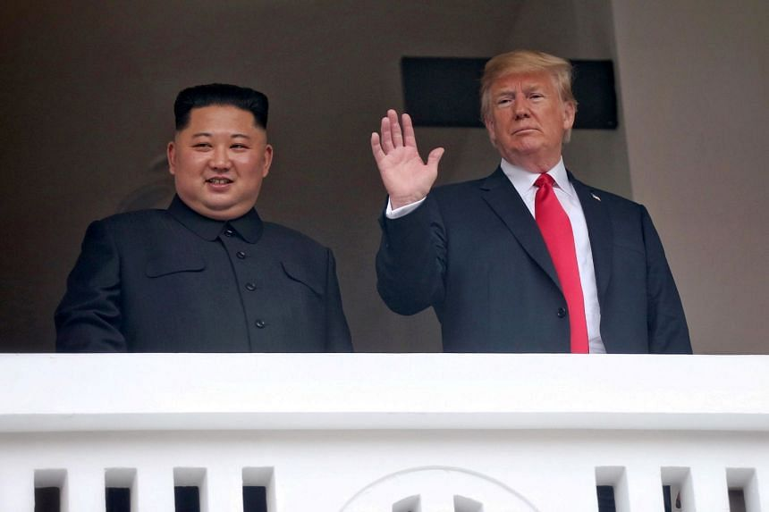 US President Donald Trump waves next to North Korean leader Kim Jong Un at the Capella Singapore, on June 12, 2018.