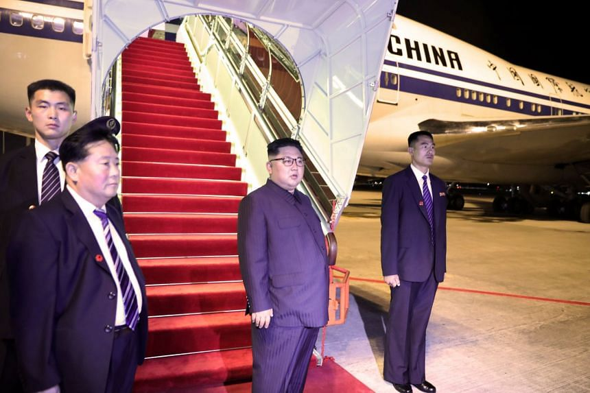 """North Korean leader Kim Jong Un preparing to depart from Changi Airport late last night after the summit. Mr Trump said he expected Mr Kim to start a process in North Korea """"that is going to make a lot of people very happy and very safe""""."""
