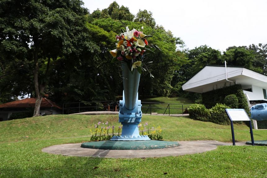 Decommissioned World War II gun barrels were decorated with flowers outside Fort Siloso.