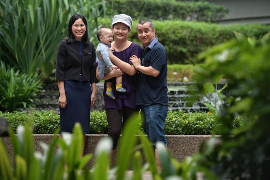 Dr Lim Geok Hoon (left) with Madam May Wong and her family. Madam Wong had the minimal scar mastectomy procedure for both breasts in August last year.
