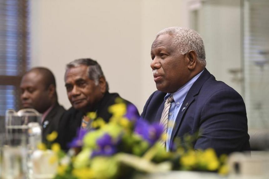 Prime Minister of the Solomon Islands Rick Houenipwela (right) speaks to Australian Prime Minister Malcolm Turnbull (not pictured) during a bilateral meeting at Parliament House in Canberra on June 13, 2018.