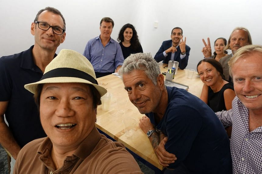 K.F. Seetoh (left, foreground) with Anthony Bourdain (centre).