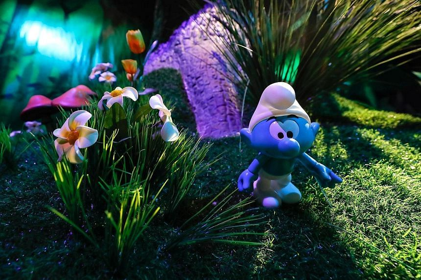 A character at the Smurf Experience exhibition, depicting a larger-than-life recreation of the Smurf village.