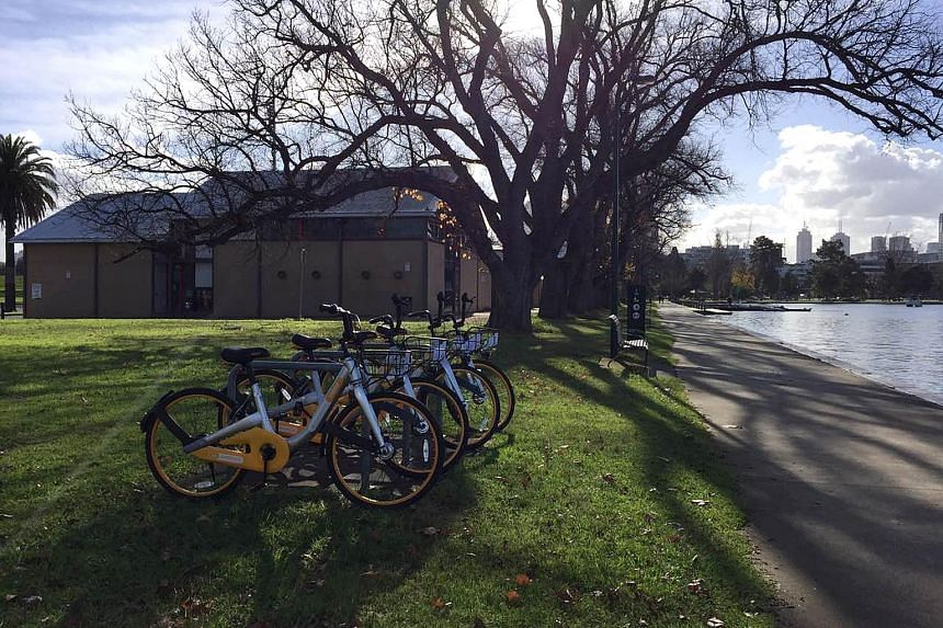 A row of oBikes seen beside the Yarra River near the Melbourne city centre. City of Melbourne tweeted the news that the yellow bikes would soon be less of an eyesore, acknowledging the role of individuals vandalising and abandoning bikes as a key pro