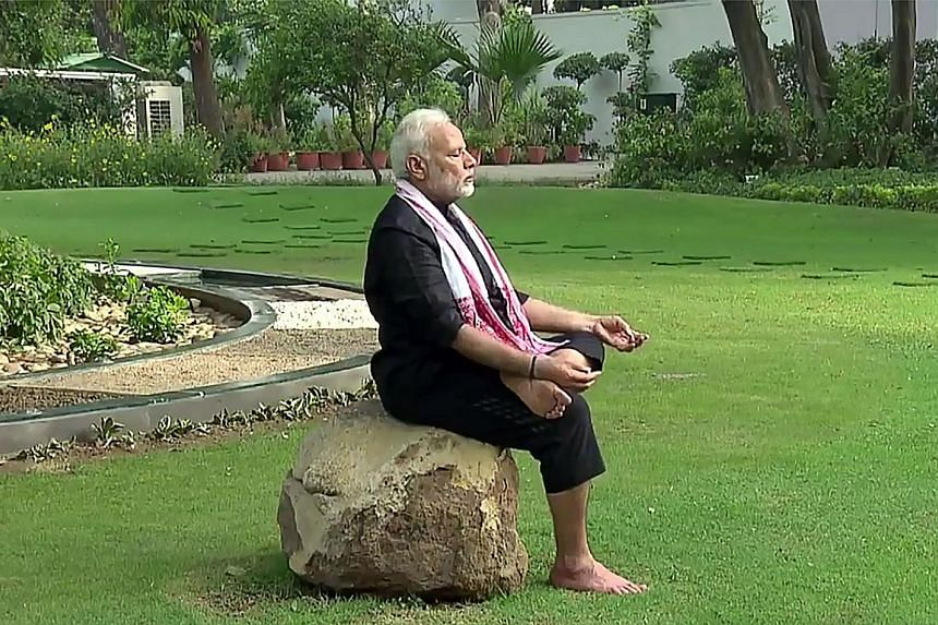 Indian Prime Minister Narendra Modi responds to a trending social media fitness challenge with a clip shot in the lush garden of his New Delhi residence. The two-minute video posted on his twitter handle yesterday shows him doing knee bends, walking