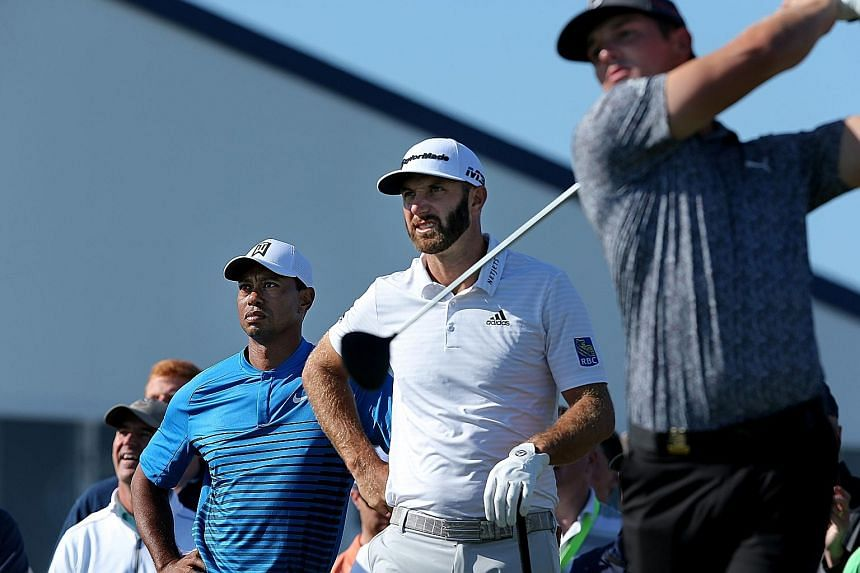 Americans Tiger Woods and Dustin Johnson look on as Bryson DeChambeau hits from the fifth tee during Tuesday's practice round before the 118th US Open at Shinnecock Hills. The 42-year-old Woods, who last played the event in 2015, will be looking for