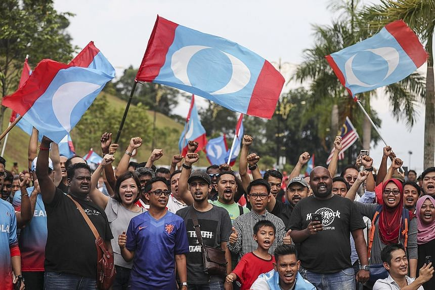 Supporters of Tun Dr Mahathir Mohamad in Kuala Lumpur on May 10. The Pakatan Harapan (PH) alliance secured a historic win in last month's general election. Analysts and politicians say the three-way split in Malay support - divided between Barisan Na
