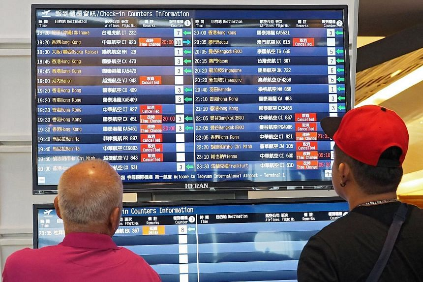 Passengers at Taiwan's Taoyuan International Airport. China's aviation regulator in April gave airlines a May 25 deadline to remove references on their websites that suggest that Taiwan, Hong Kong and Macau are countries independent of China. It late