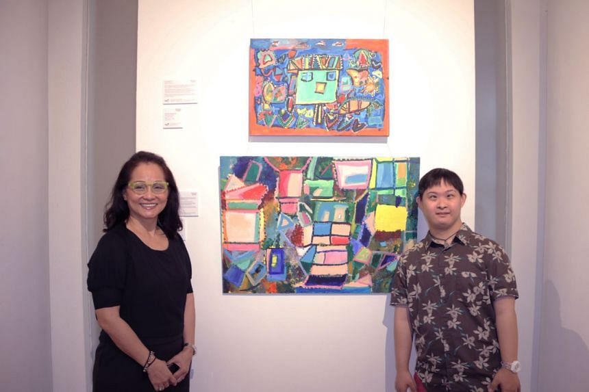 Mr Cavan Chang and his mother, Madam Cecilia Lai, with his pieces at the exhibition.