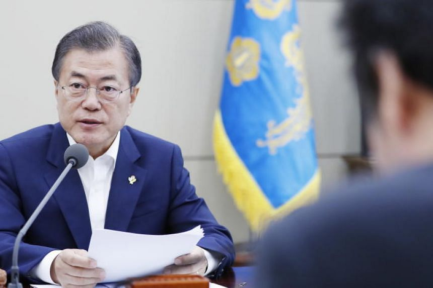 South Korean President Moon Jae In presiding over a national security meeting at the Blue House in Seoul on June 14, 2018.