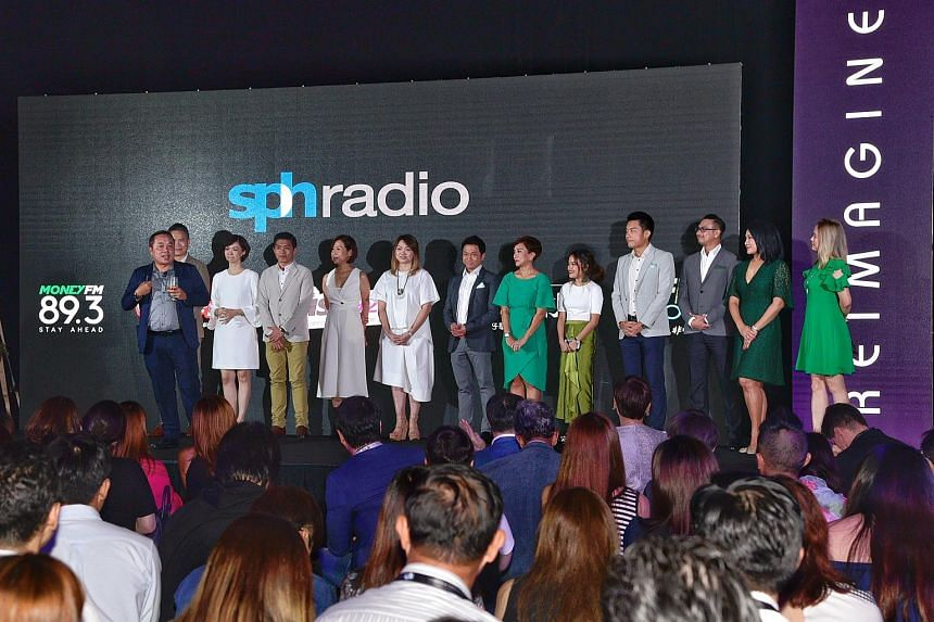 SPH Radio general manager Sim Hong Huat (left) introducing the radio DJs from Money FM 89.3FM, and for 96.3 Hao FM on Nov 10, 2017. The two stations helped boost the numbers for SPH Radio, with more than 600,000 people tuning in in May 2018.