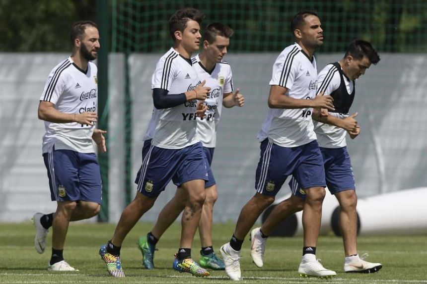 Argentina's footballers (from left) forward Gonzalo Higuain, forward Paulo Dybala, midfielder Giovani Lo Celso, midfielder Enzo Perez and defender Marcos Acuna jog during a training session at the team's base camp in Bronnitsy, near Moscow, on June 1
