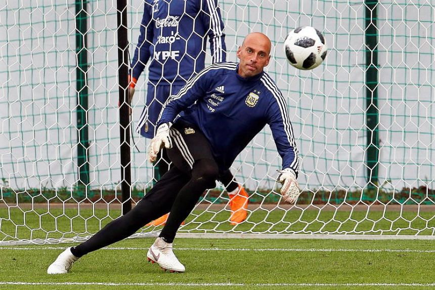 Argentina's goalkeeper Willy Caballero performs during his team's training session in Bronnitsy, Russia, on June 13, 2018.