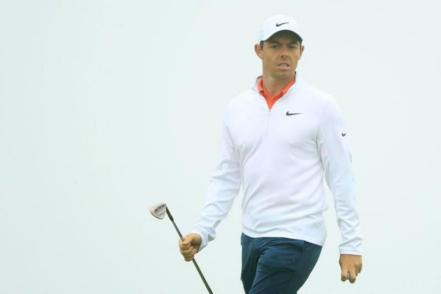 Rory McIlroy of Northern Ireland looks on from the tenth green during a practice round prior to the 2018 US Open at Shinnecock Hills Golf Club on June 13, 2018 in Southampton, New York.