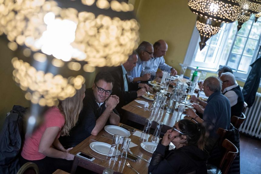 File photo showing patrons dining at a restaurant in London, on Oct 16, 2017. Britain's high street is suffering from weak consumer spending and intense competition.