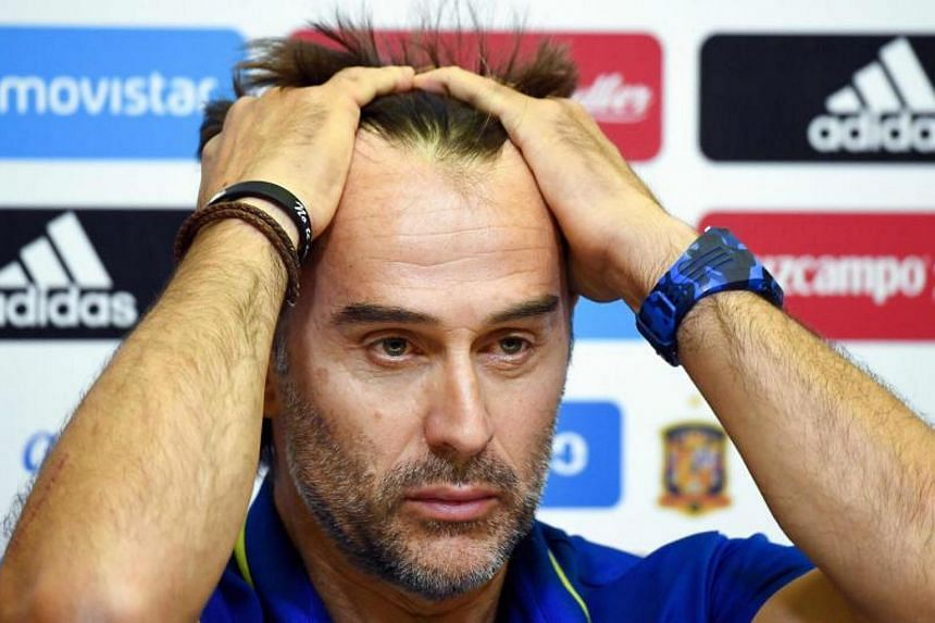 """Spain's coach Julen Lopetegui gestures during a press conference at the Royal Spanish Football Federation's """"Ciudad del Futbol"""" in Madrid on Sept 1, 2017."""