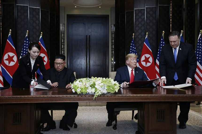 US President Donald Trump and North Korean leader Kim Jong Un during the summit at Capella Singapore, on June 12, 2018.