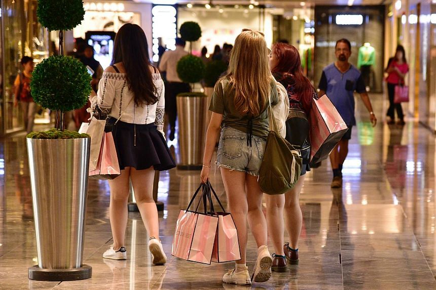 Shoppers in The Paragon on Orchard Road.