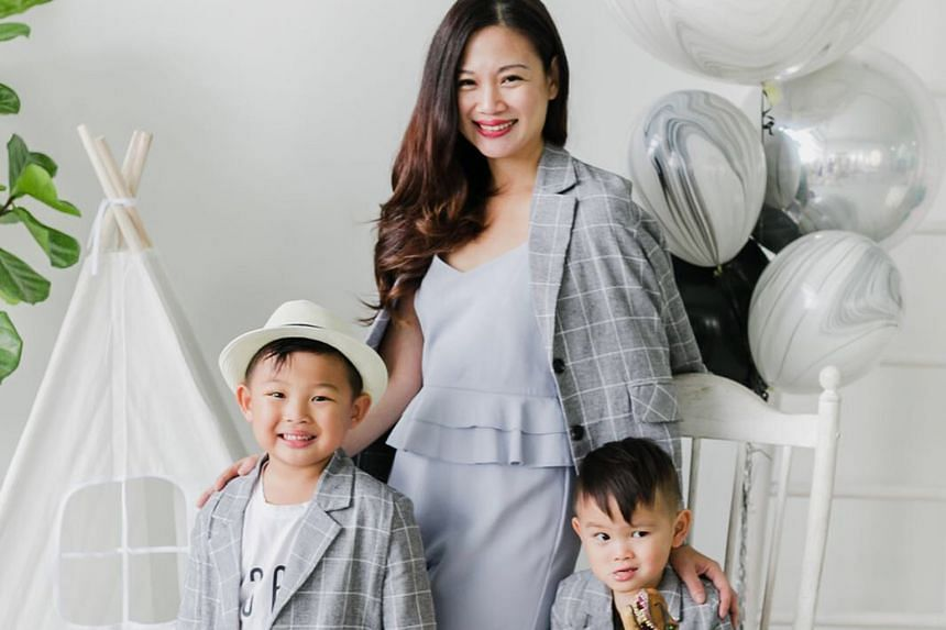 Ms Tjin Lee with sons Tyler, five, and Jake, two. She feels it is common practice for, say, magazines to show just the final, touched-up images.