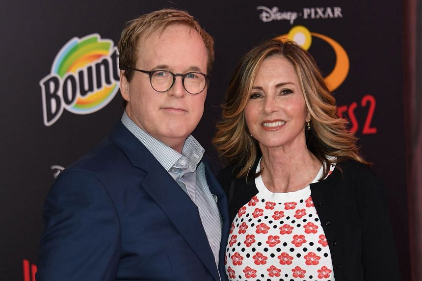INCREDIBLES 2 WRITER-DIRECTOR BRAD BIRD (with his wife Elizabeth Canney)