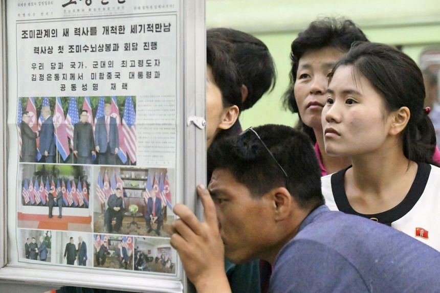 North Koreans reading about the summit in a local newspaper on display at a subway station in Pyongyang. While North Korea's state media heralded a new chapter in ties between Pyongyang and Washington, South Korea's leading newspapers lamented th