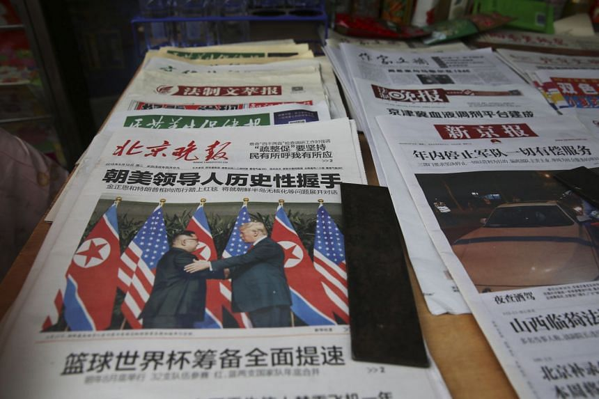 The historic summit dominated the front pages of newspapers around the world, including those in China (above), Japan and Australia.