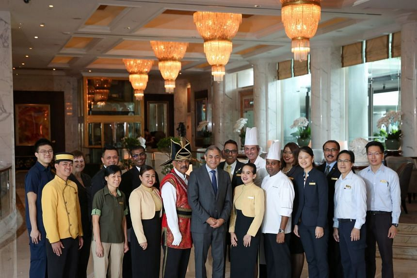 General manager Bipan Kapur (centre, in suit) and head butler Hussain Khan (behind him, in suit), with the Shangri-La team involved in coordinating the US delegation's stay. They had only about a month to prepare.