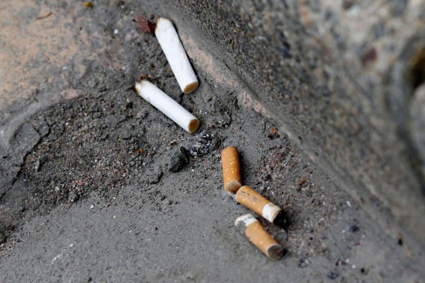 Cigarette butts litter the street in Rochefort, France, on June 14, 2018.