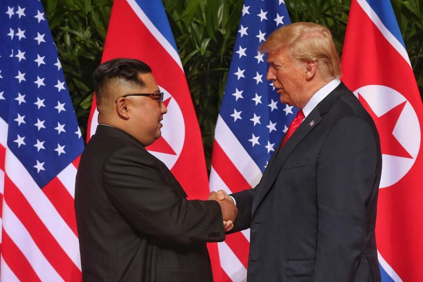 US President Donald Trump shakes hands with North Korean leader Kim Jong Un at the courtyard of Capella Singapore on June 12, 2018.