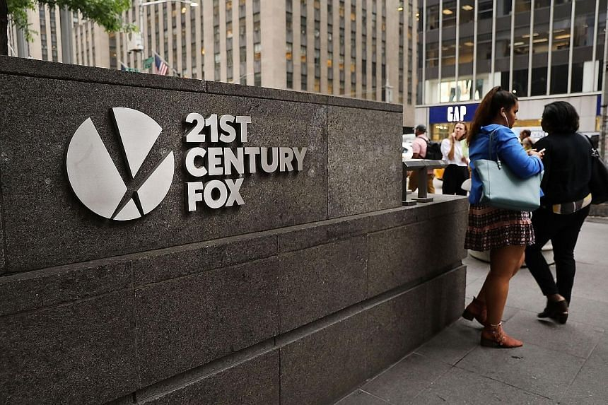 The headquarters of 21st Century Fox in New York City. Comcast's all-cash bid sets up a showdown with the Walt Disney Co for Mr Rupert Murdoch's media empire. There is bad blood between Disney and Comcast, stretching back to at least 2004, when Comca