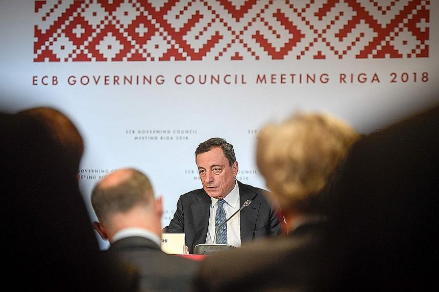 European Central Bank president Mario Draghi at a press conference following the meeting of the bank's governing council in Riga, Latvia, yesterday.