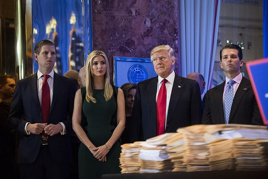 The lawsuit filed against the Donald J. Trump Foundation seeks to bar US President Donald Trump (third from left) and his children (from left) Eric, Ivanka and Donald Jr from serving on non-profit organisations.