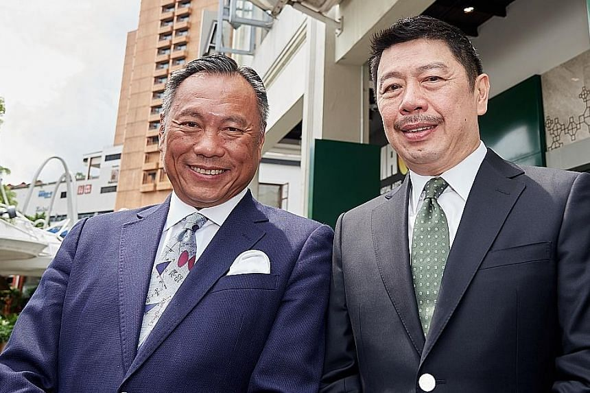 The Tsui Wah outlet in Singapore will also serve dishes like king prawns in XO sauce with tossed noodles (right). The Tsui Wah outlet in Singapore is a joint venture headed by Tsui Wah Holdings chief executive Peter Pang (left) and Jumbo Group chief