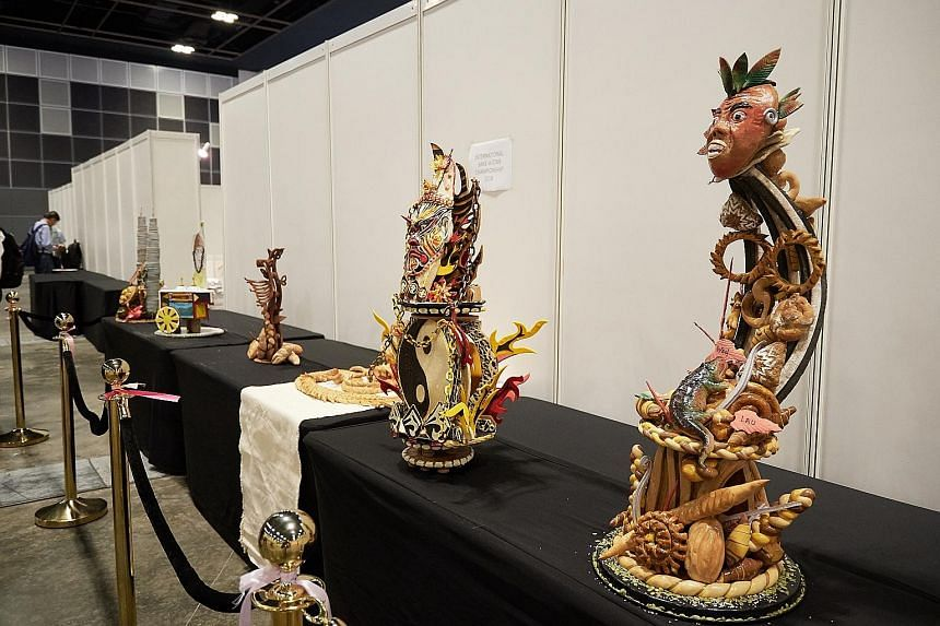 Showpieces by competitors from Singapore (right) and Taiwan (second from right) created for the International Bake-A-Star championship. Local talents will battle it out in the Singapore Bake-A-Star championship today and tomorrow. The team behind Ms