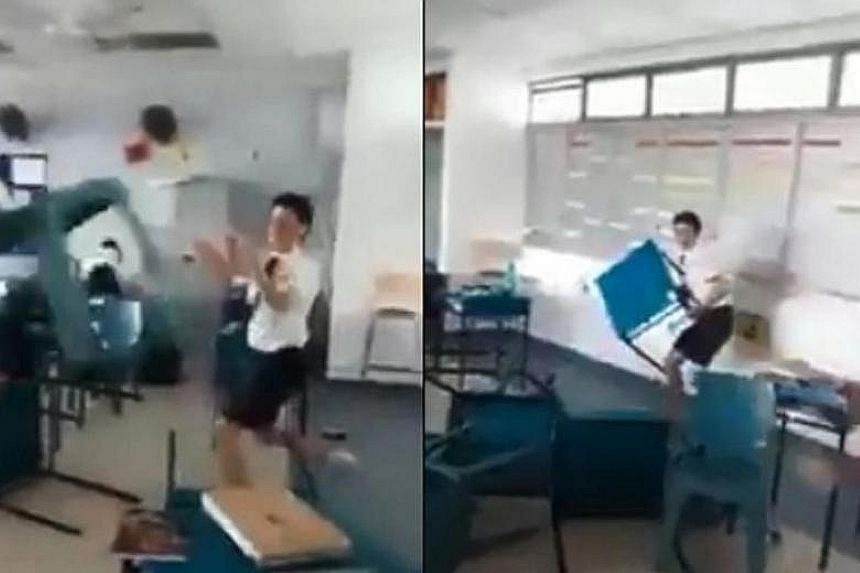 In the viral video, two students can be seen throwing chairs and desks across the classroom and at each other as others try to leave.