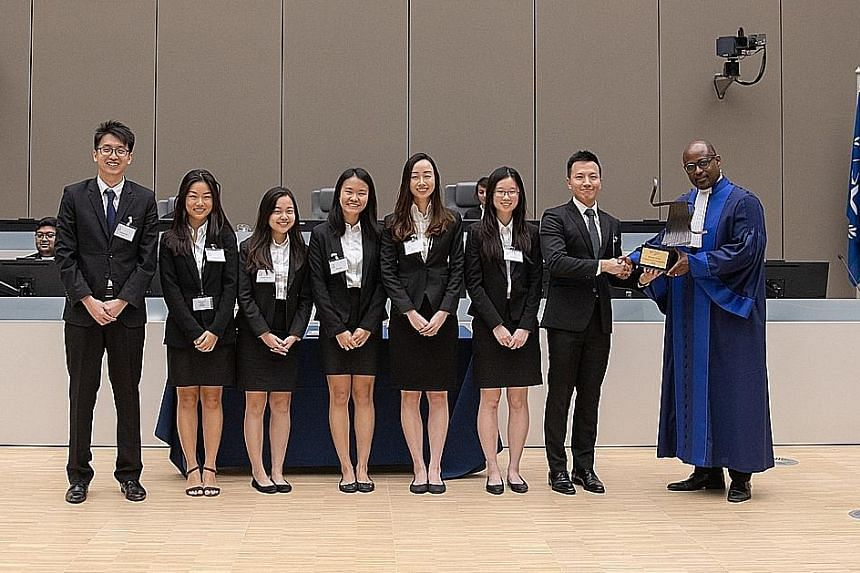 (From far left) SMU team members Sampson Lim, Ilene Chua, Tessa Tan Si Ying, Tracy Gani, Yu Zheng Yi, Ng Pei Qi and Lee Chuan with ICC judge Geoffrey A. Henderson. They beat top student teams from across the globe to win the competition.
