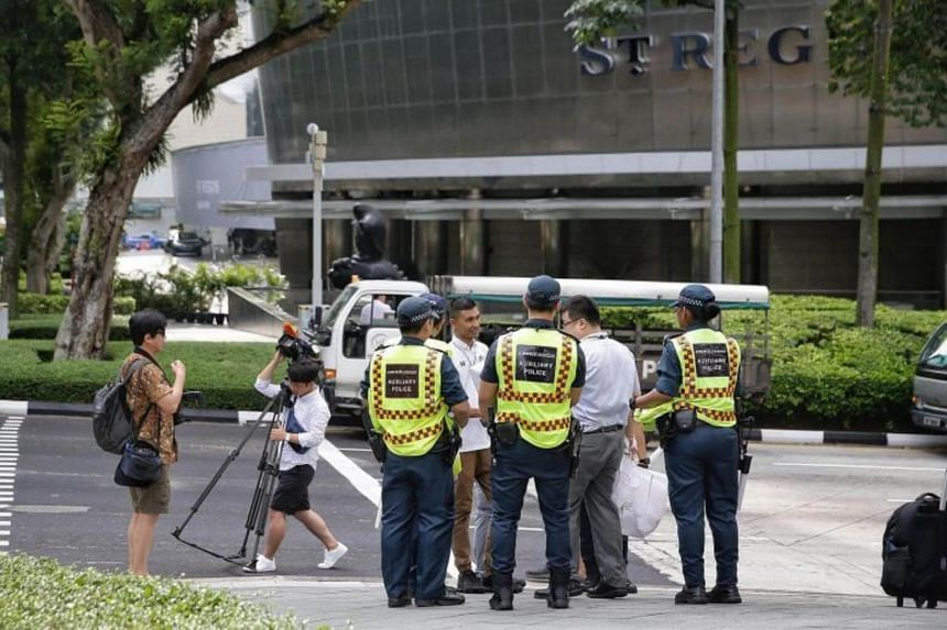 Foreign media and members of the auxiliary police standing outside The St Regis Singapore on June 9, 2018.