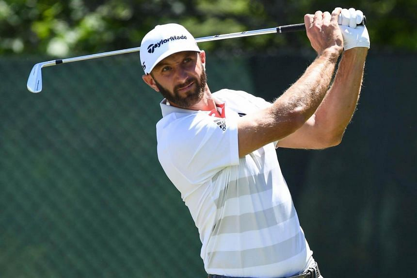 Dustin Johnson tees off the second hole during the first round of the US Open golf tournament, on June 14, 2018.