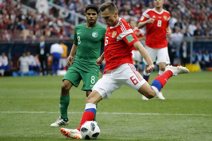 Denis Cheryshev of Russia (right) and Yahya Al-Shehri of Saudi Arabia in action during the FIFA World Cup 2018 group A preliminary round football match in Moscow, Russia, 14 June 2018.