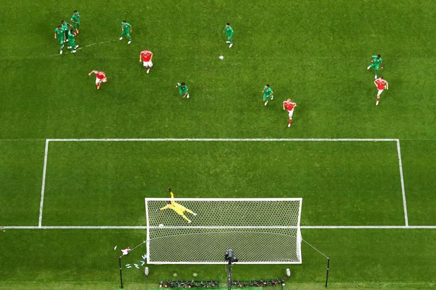 Russia's Aleksandr Golovin (not pictured) scores the team's fifth goal in the match against Saudi Arabia, in Moscow, on June 14, 2018.