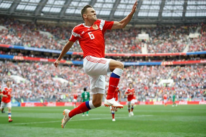 Russia's Denis Cheryshev celebrates scoring the team's second goal during the match against Saudi Arabia.