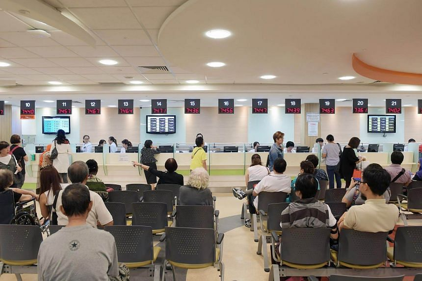 File photo showing patients waiting at a pharmacy at Singapore General Hospital, on March 3, 2017.