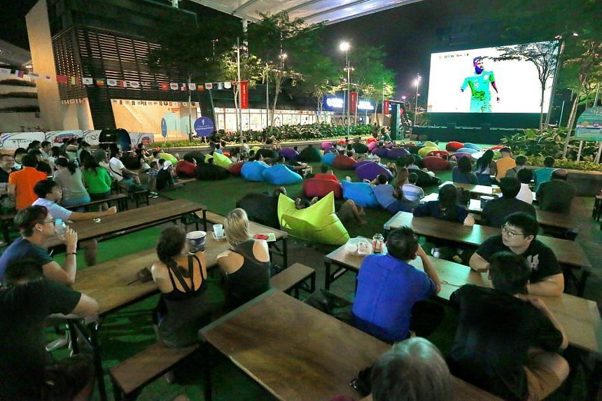 People at the live screening of the World Cup at OCBC Square on June 14, 2018.