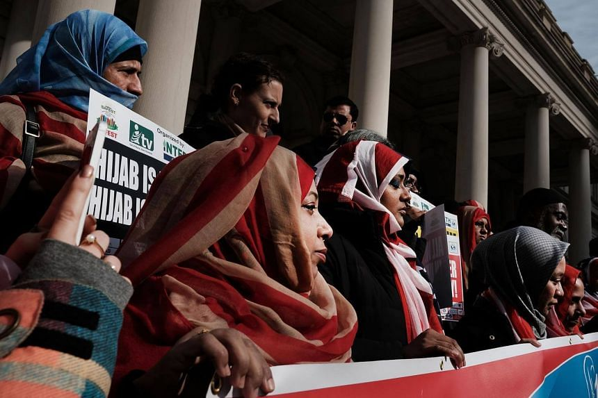 Women wearing an American flag head scarf at an event at City Hall for World Hijab Day in New York City, on Jan 31, 2017.