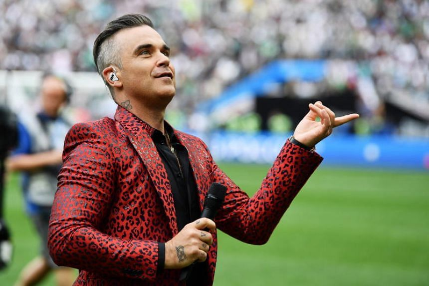 English singer Robbie Williams performs during the opening ceremony prior to the FIFA World Cup 2018 group A preliminary round soccer match between Russia and Saudi Arabia in Moscow, Russia, on June 14, 2018.