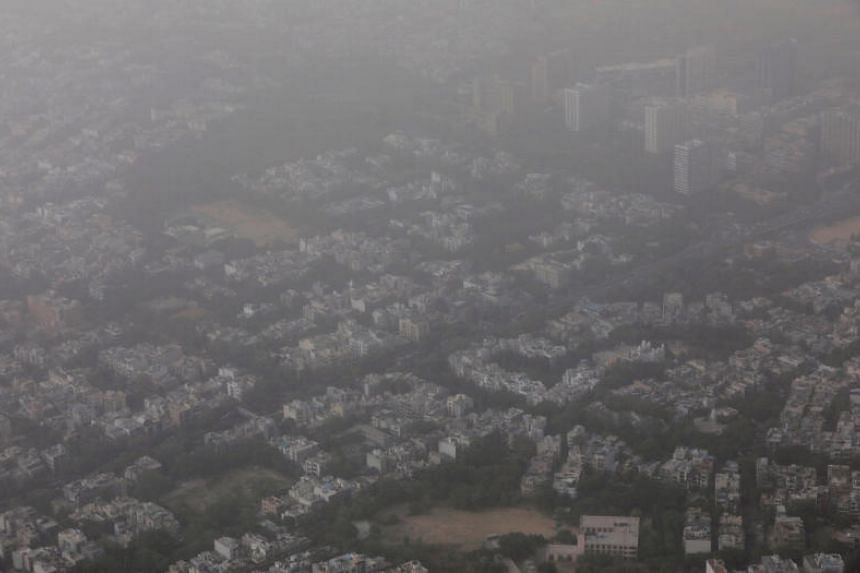Buildings are seen blanketed by haze and dust on the outskirts of New Delhi, India, on June 14, 2018.