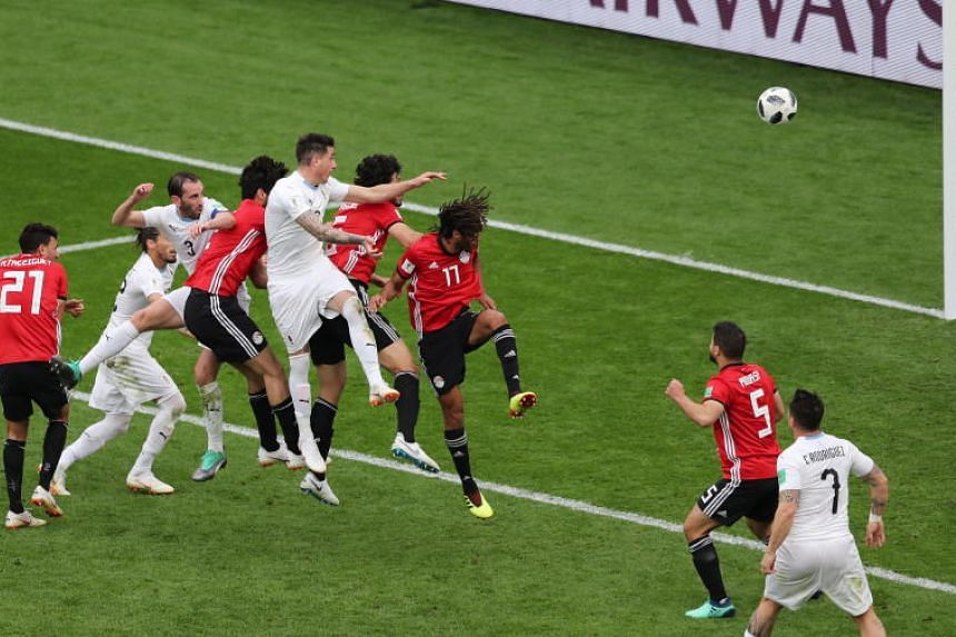 Jose Gimenez (centre) of Uruguay scores the 1-0 during the FIFA World Cup 2018 group A preliminary round soccer match between Egypt and Uruguay in Ekaterinburg, Russia, on June 15, 2018.